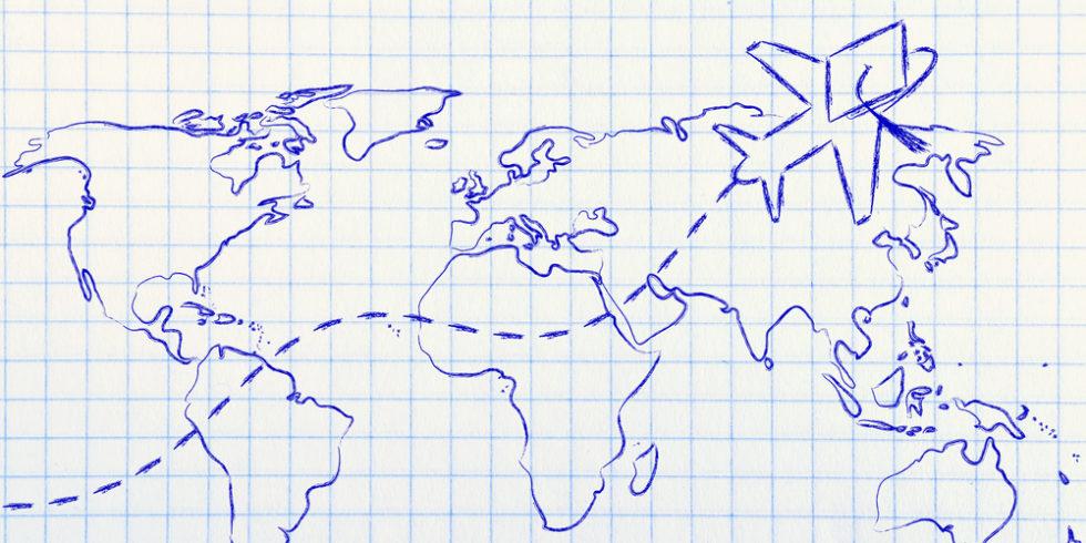 gezeichnete Weltkarte auf kariertem Papier