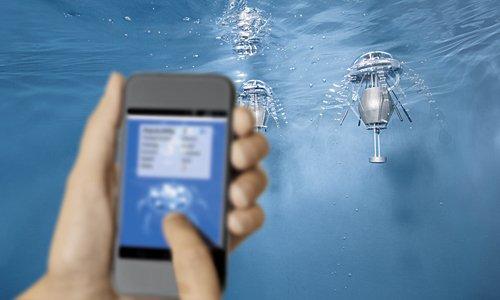 Kommunikation mit Aquajellies: Festo hat ein Smartphone-App entwickelt, mit dem man die künstlichen Quallen steuern und ihre Kommunikation untereinander beobachten kann.