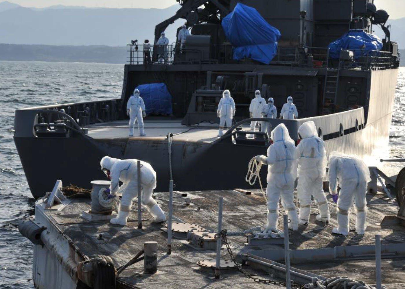 Arbeiten zur Kühlung der Reaktoren am havarierten Atomkraftwerk Fukushima im April 2011: Die Katastrophe begann am 11. März mit einem Erdbeben. Kurze Zeit später kam es in drei Reaktorblöcken zum Gau.