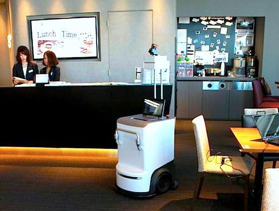 Der rollbare Robot Printer von Fuji Xerox, unterwegs in einem Großraumbüro: Der neuartige Drucker rollt zum Schreibtisch und druckt am Arbeitsplatz des Mitarbeiters die gewünschten Dokumente aus. Anschließend verschwindet er wieder.