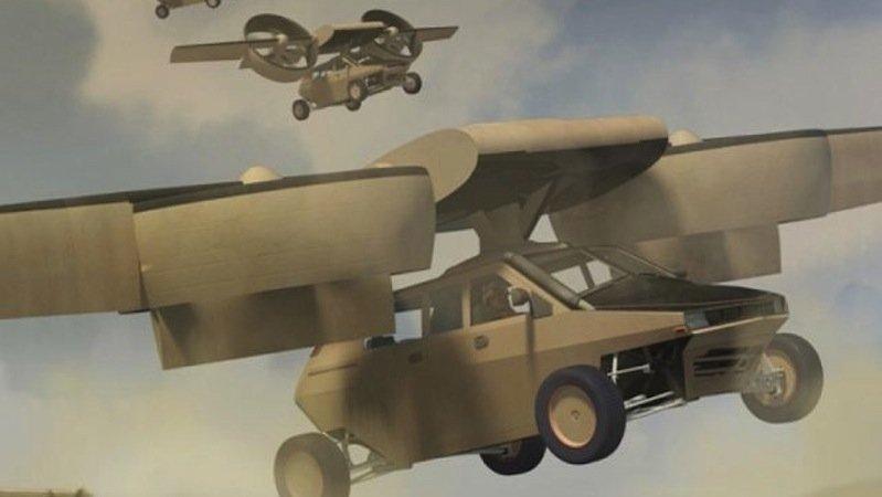 Transformer TX des Konkurrenten Lockheed Martin. Die unbemannte Drohne ist eine Art riesiger Roboter-Adler und krallt sich kurzerhand Autos und Container.