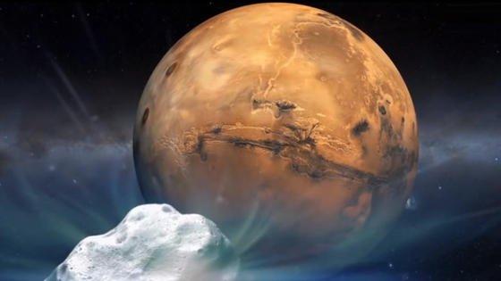 Die künstlerische Darstellung zeigt den Kometen Siding Spring, der am 19. Oktober 2014 in knapp 140.000 Kilometern Entfernung am Mars vorbeiraste. Die US-Raumfahrtbehörde NASA beobachtete das astronomische Ereignis mit mehr als einemDutzend verschiedener Raumsonden,Teleskope und Marsfahrzeuge.