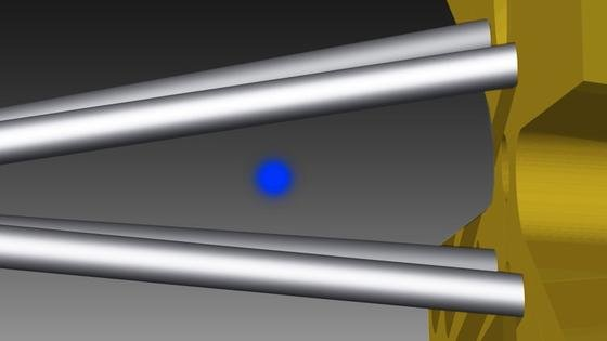 Ein Ion in einer Paul-Falle: Die Wärmekraftmaschine wird durch die auseinanderlaufenden Stäbe realisiert. Die Quetschung erfolgt, indem spezielle elektrische Felder angelegt werden.