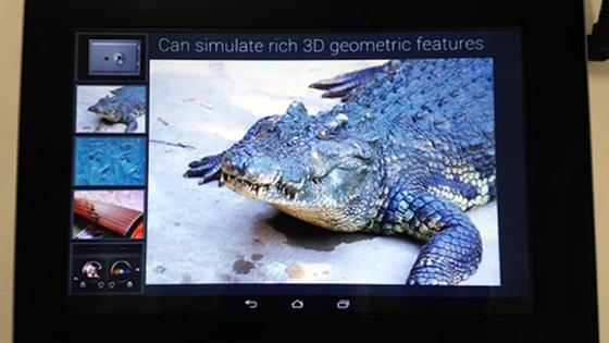 Auf dem neuen Fujitsu Bildschirm wird der Rückenpanzer eines Krokodils fühlbar. Unter dem Bildschirm sind Ultraschallsensoren angebracht, die die Reibung zwischen den dargestellten Panzerschuppen erhöhen und verringern.