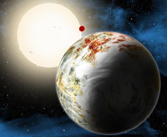"""Im Bild vorne ist die neu entdeckte """"Mega-Erde"""" Kepler-10c zu sehen, dahinter die kleine Lava-Welt Kepler-10b. Gemeinsam umkreisen sieeinen sonnenähnlichen Stern im Sternbild Draco."""