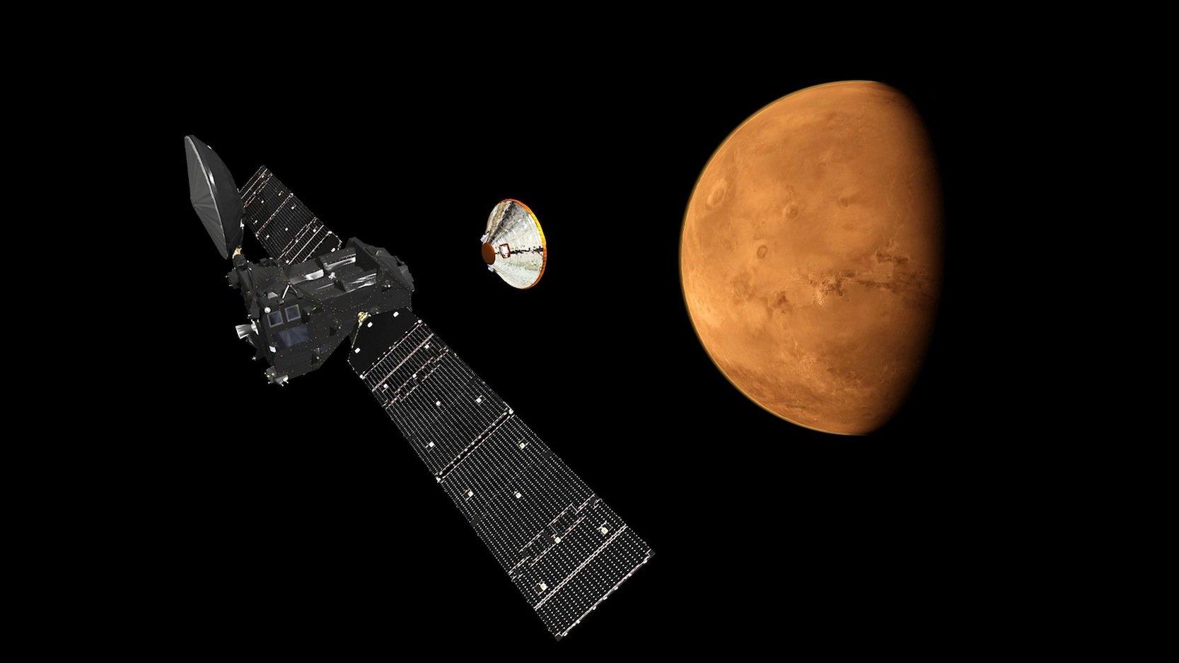 Künstlerische Darstellung des Trace Gas Orbiters der ExoMars 2016-Mission. Er trennt die Landesonde Schiaparelli ab, die dann sanft in Richtung Marsoberfläche hinabgleiten soll.