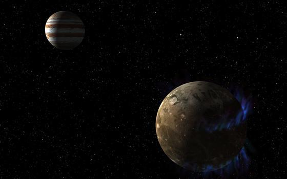 Künstlerische Darstellung:Das Magnetfeld des Jupiter-Mondes Ganymed erzeugt tanzende Polarlichter (blau). Für die Kölner Forscher der Beweis, dass sich unter der Oberfläche ein gigantisches Eismeer befindet.