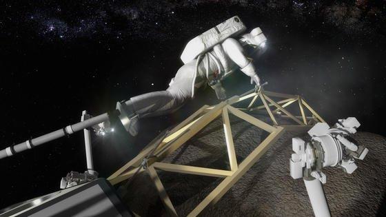 Ein Astronaut bereitet die Untersuchung des Asteroiden-Felsbrockens vor.