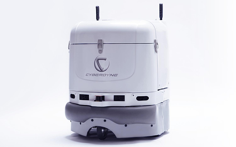 Ein kleiner Putzroboter von Cyberdyne: Er kann sogar selbstständig mit dem Fahrstuhl fahren.