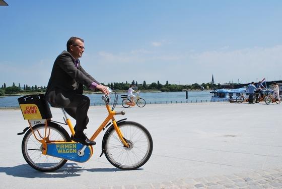 Ein standorttypisches Design, wie bei den melonengelben Räder aus Mainz, hilft beim aktiven Stadt-Management. Solche öffentlichen Leihfahrräder sind ein perfekter Werbeträger für das Fahrradfahren im Alltag.