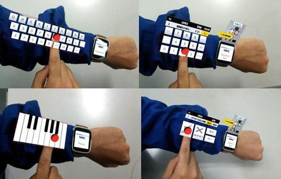 Im Zusammenspiel mit Datenbrille und Smartwatch erzeugt eine neue Software vom Japanischen Elektronikkonzern NEC eine virtuelle Tastatur auf dem Arm. Das soll die Arbeit in Fabriken und Krankenhäusern erleichtern.