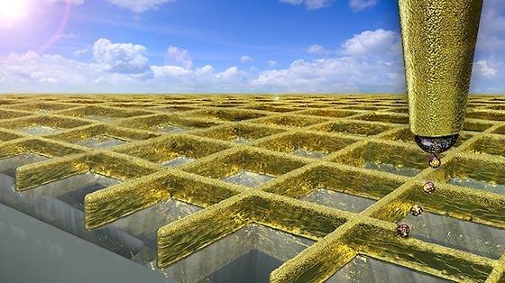 Illustration: Mithilfe des elektrohydrodynamischen Tintenstrahldrucks können die Schweizer Wissenschaftler ein Gitternetz aus extrem feinen Goldwänden drucken.