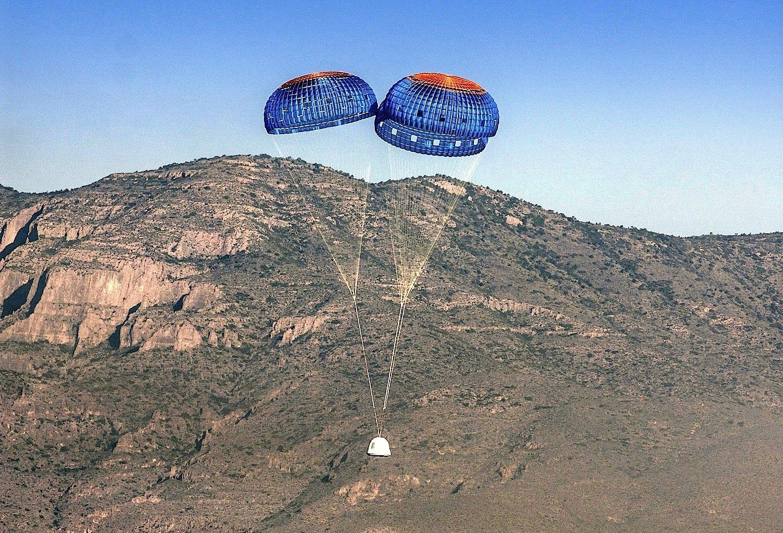 Die Kapsel der New Shepard kehrt an Fallschirmen zur Erde zurück. Zukünftig könnte sie Weltraumtouristen an Bord haben.