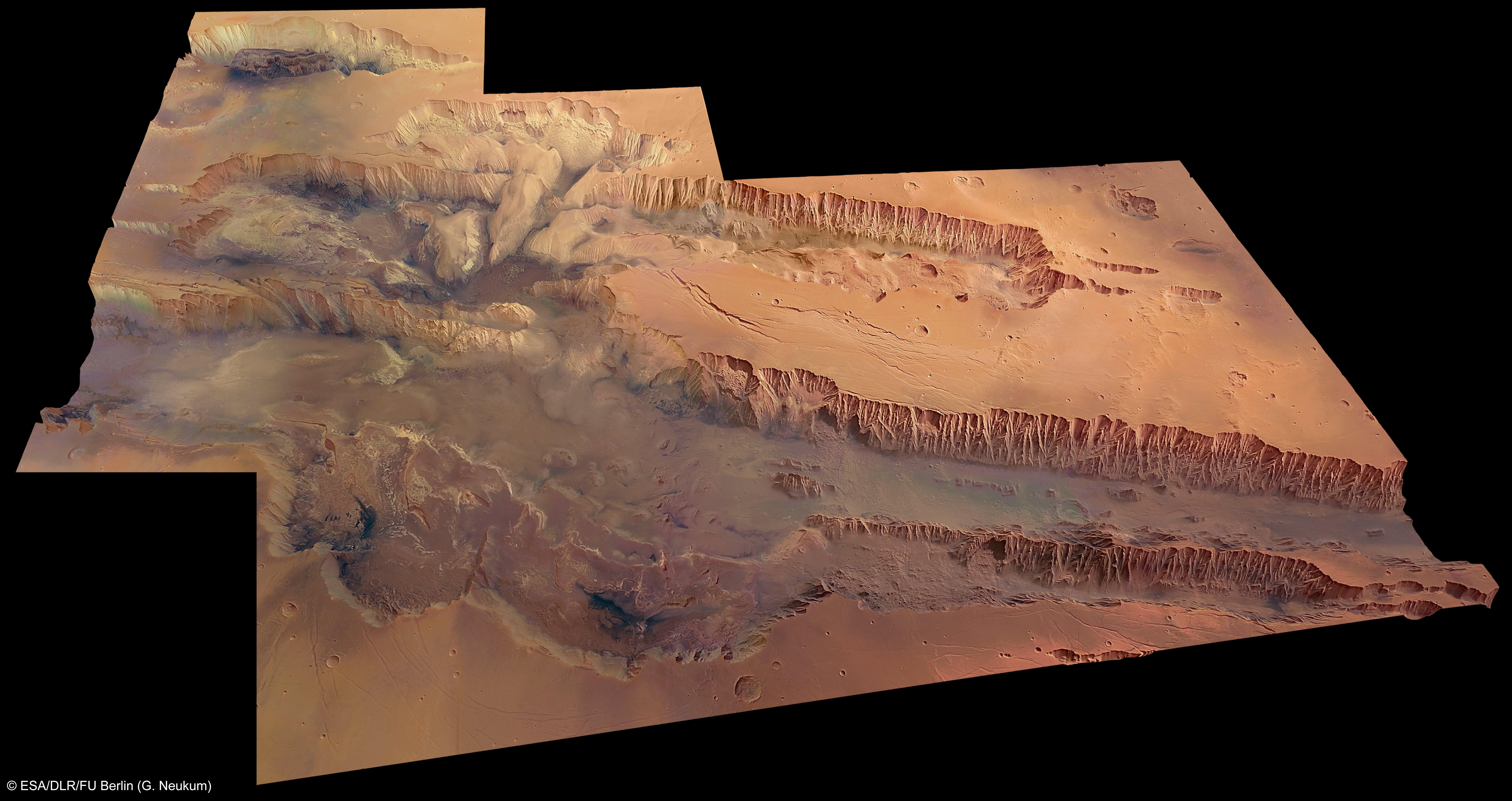 Talsystem der Valles Marineris: Dieser bis zu elf Kilometer tiefe und bis zu 200 km breite Grabenbruch erstreckt sich über fast 4000 km Ost-West-Richtung entlang des Äquators durch das Marshochland. Zum Vergleich: Der Grand Canyonin den USA ist nur knapp zwei Kilometer tief undwürde leicht in eines der parallel verlaufenden Seitentäler passen.