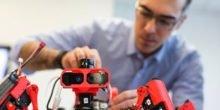 Vernetzte Roboterspinnen drucken autonom Karosserien