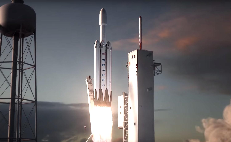 Illustration der Falcon Heavy. An den Seiten der Trägerrakete sind zwei zusätzliche Falcon-9-Erststufen angebracht. Mit 27 Merlin-Triebwerken soll die Falcon Heavy die leistungsstärkste Rakete der Welt sein.