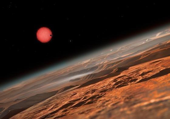 Im Sternbild Wassermann haben Forscher den Planeten Trappist-1 entdeckt. Die künstlerische Illustration zeigt Trappist-1 im Hintergrund, im Vordergrund zu sehen die Oberfläche eines der drei erdähnlichen Planeten, die den Trappist-1 umkreisen.