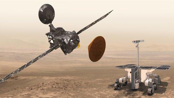 Da waren es nur noch zwei: Die künstlerische Darstellung der ESA zeigt Schiaparelli, den Trace Gas Orbiter und den ExoMars-Rover. Doch die ExoMars-Sonde Schiaparelli ist nicht wie geplant am 19. Oktober 2016 sanft auf dem Roten Planeten gelandet. Es kam zu einer Bruchlandung und womöglich auch zu einer Explosion. Der genaue Hergang muss noch ermittelt werden.