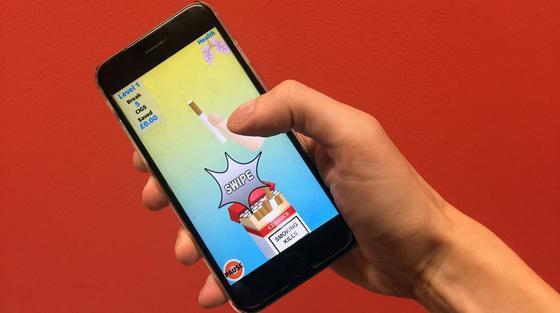 Zum Smartphone statt zur Zigarette greifen: Britische Forscher haben eine Spiele-App entwickelt, die Rauchern helfen soll, sich von dem Laster zu befreien.