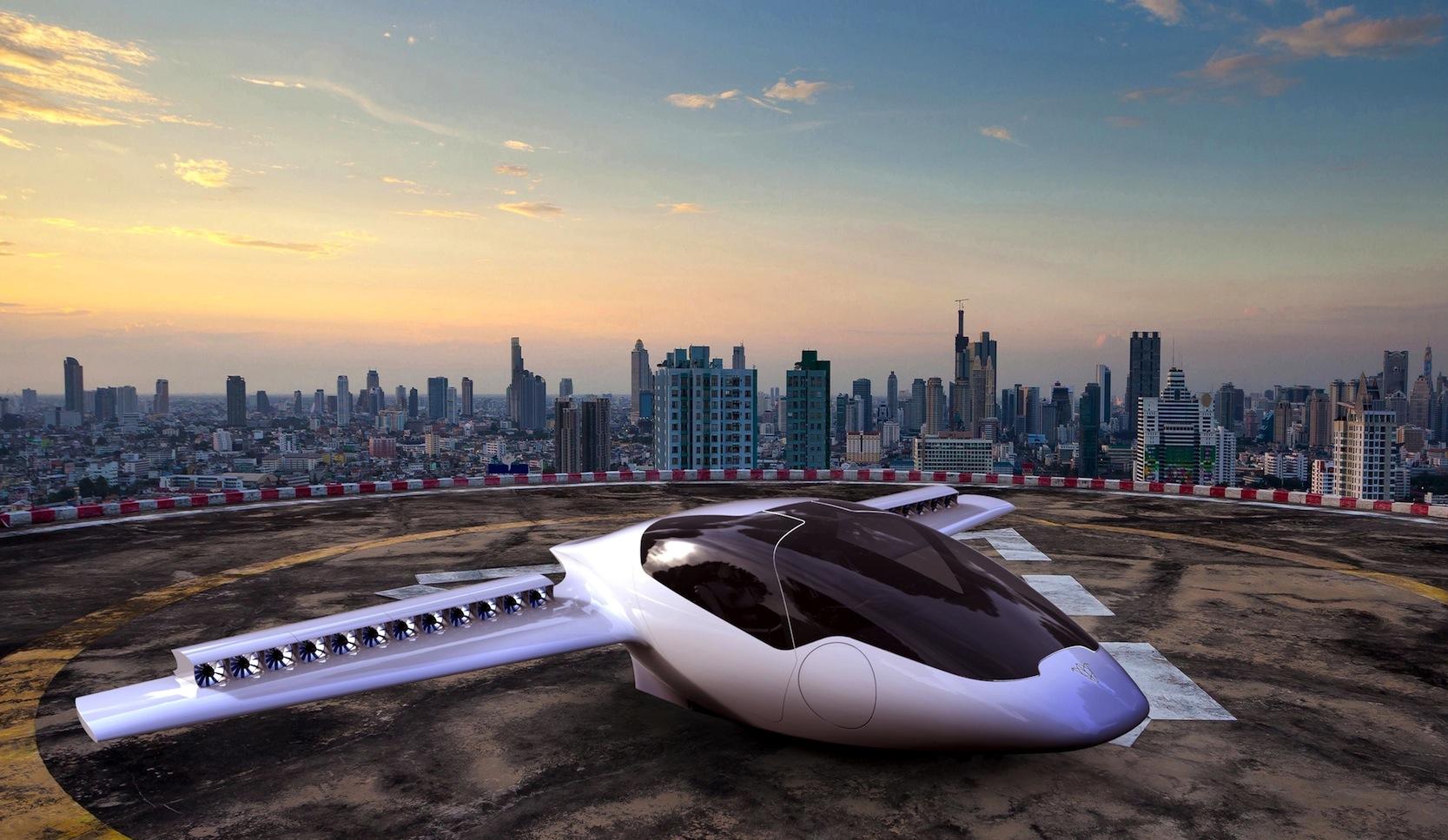 Das fliegende Auto Lilium-Jet auf dem Dach eines Hochhauses: 2018 wollen junge Ingenieure aus Bayern die Kombination aus Kleinflugzeug und Auto auf die Straße und die Luft bringen.