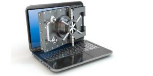 Laptop mit Tresorschloss vor dem Bildschirm
