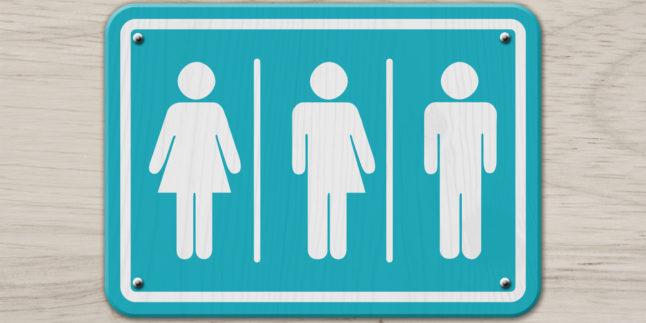 Anzeigentafel mit Strichfigur für Frau, Intersexuell und Mann