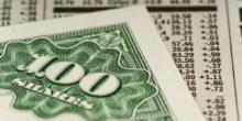 """Grünes Wertpapier mit der Aufschrift """"100 Shares"""""""