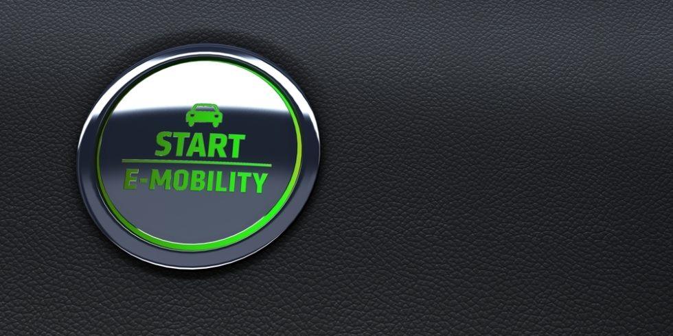 """elektrischer Anlasser-Button mit der Aufschrift """"Start E-Mobilität"""