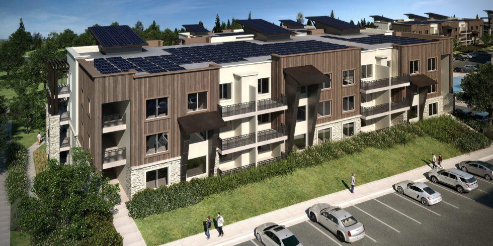 Wohnhäuser mit Solarenergie davor Autos
