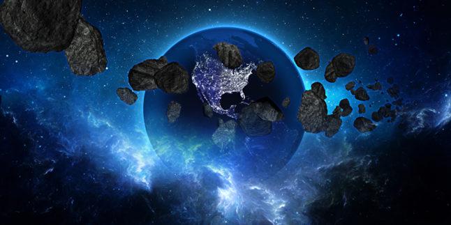 Erde mit Asteroiden im Weltall