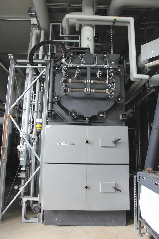 Der Hackschnitzelkessel Vitoflex 300-FSB von Viessmann hat eine thermische Leistung von 1,1 Megawatt. Bild: Bioenergiegenossenschaft Mengsberg