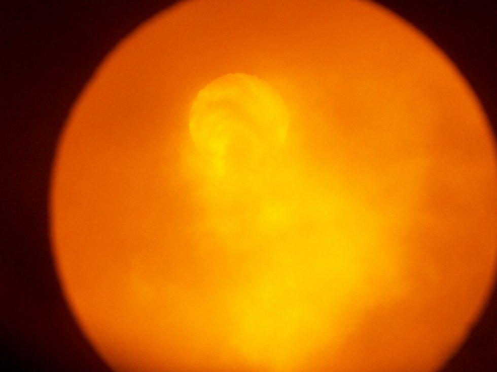 Blick durch das Schauglas auf die Flamme in der Nachbrennkammer.  Bild: Carbotechnik Energiesysteme GmbH