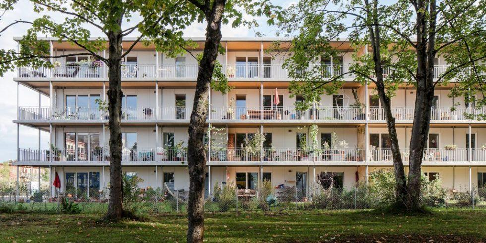 Beim Mehrfamilienhaus Nest4 überzeugen die Materialeigenschaften des Baustoffes Holz. Foto: Gabriel Büchelmeier