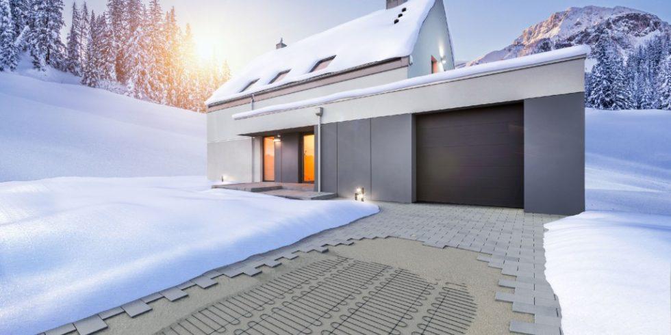 Elektrische Freiflächenheizsyteme ermöglichen Schnee- und eisfreie Einfahrten ohne die Umwelt mit Salz zu belasten. Foto: BVF