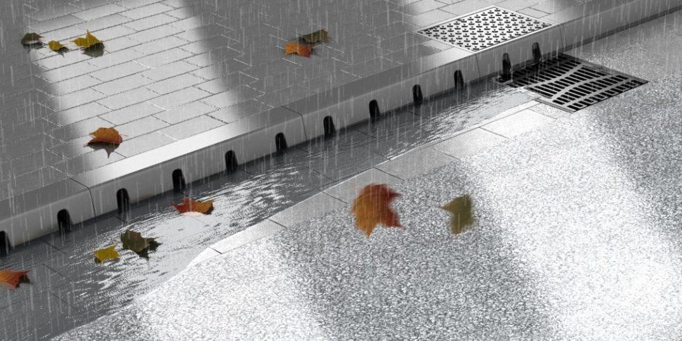 Kommunen brauchen für Überflutungs-Hot-Spots neue Lösungen, eine Kombination aus Bordsteinentwässerung und Straßenablauf kann dies sein. Foto: ACO Tiefbau.